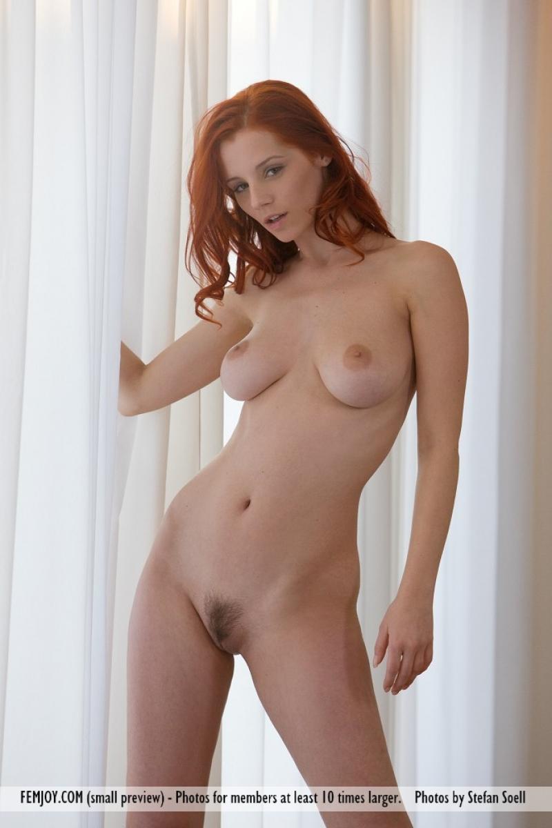busty redhead nude