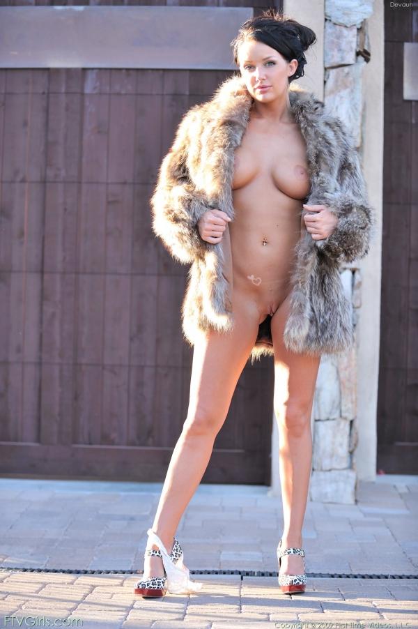 Naked women in fur coat speaking