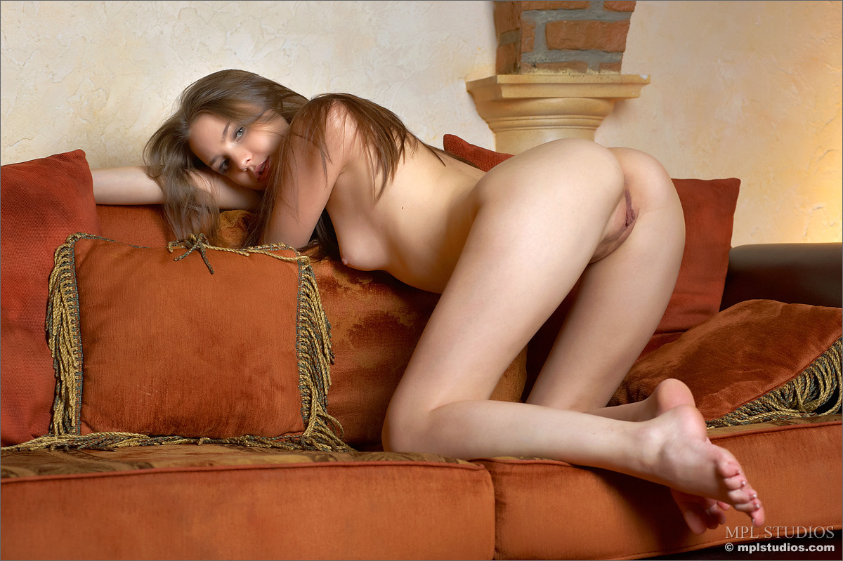 topless girl on couch drinking