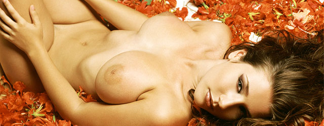 Erica Campbell In A Bed Covered With Flowers