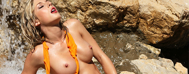 Super Fit Blonde Resting Naked On The Rocks