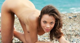 skinny-exotic-girl-naked-on-a-rocky-beach