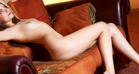 slim-naked-girl-amelie-posing-naked-on-a-couch