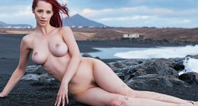 busty-redhead-teasing-at-the-beach