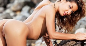 stunning-tight-bodied-nude-model-teases-on-a-rocky-shore