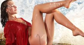 wet-brunette-model-teasing-on-a-rocky-shore