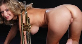hot-blonde-girl-poses-naked-with-a-trumpet