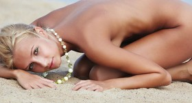 petite-nude-beach-blonde-having-fun