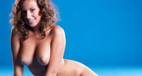 busty-nude-girl-with-curly-hair-teasing
