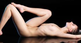 flexible-wet-brunette-shows-her-moves