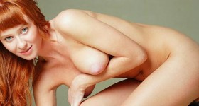 sexy-nude-redhead-girl-posing-on-a-bar-stool