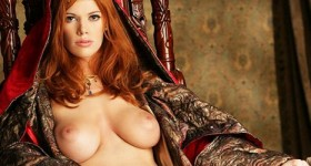 busty-redhead-sitting-on-a-throne