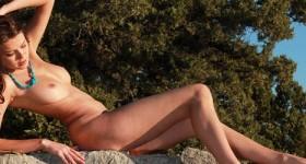 babe-sunbathing-on-a-rock