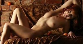 nude-redhead-in-dim-light
