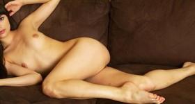 exotic-nude-girl-strips-on-sofa