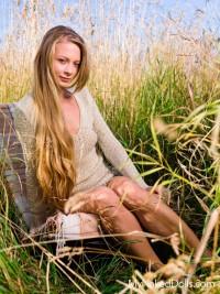 Leggy Blonde in a Sweater